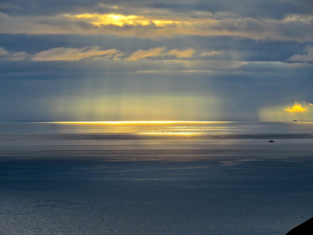 Sunlight on the water off the coast of Skye.