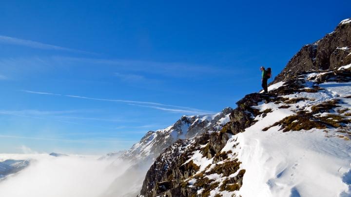 Annie standing above a glen full of mist.